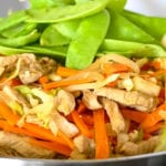 Image of pancit with chicken, carrots, sweet peas and cabbages